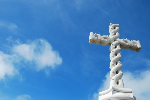 beautiful antique cross with sky background